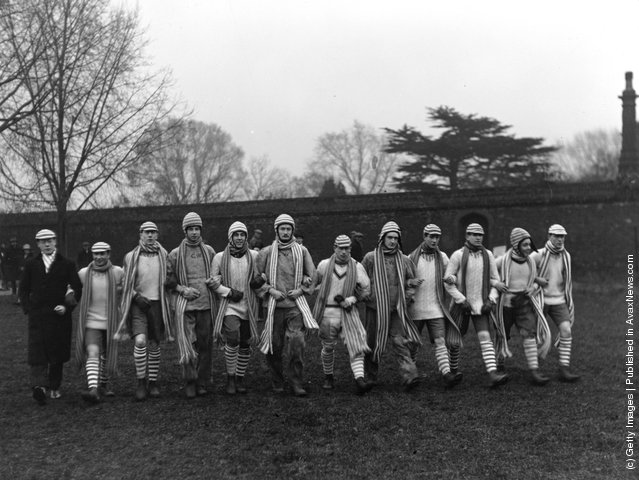 The Collegers team enter the field for the 87th Wall Game against the Oppidans on St Andrew's Day at Eton College, 30th November 1927