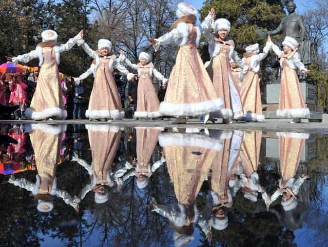 """Kyrgyz actors, wearing their traditional costumes, sing and dance during the festivities of Maslenitsa on February 26, 2017 in the Kyrgyzstan's capital Bishkek. """"Maslenitsa"""" or Shrovetide, also known as the Butter Week, the Pancake week, or the Cheesefare Week, is a Russian religious and folk holiday. It is celebrated during the last week before Great Lent – that is, the seventh week before Easter. Maslenitsa corresponds to the Western Christian Carnival. (Photo by Vaycheslav Oseledko/AFP Photo)"""