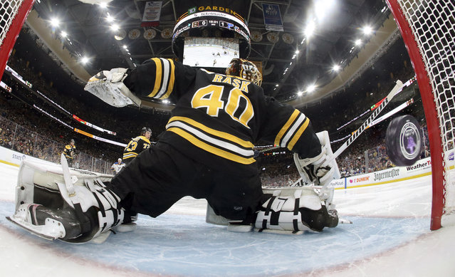 A puck shot by St. Louis Blues' Vladimir Tarasenko, of Russia, sails past Boston Bruins goaltender Tuukka Rask (40), of Finland, for a goal during the second period period in Game 1 of the NHL hockey Stanley Cup Final, Monday, May 27, 2019, in Boston. (Photo by Bruce Bennett/Pool via AP Photo)