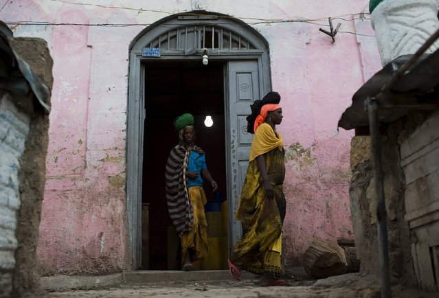 Women leave a bakery in the old walled town of Harar in eastern Ethiopia, May 19, 2015. (Photo by Siegfried Modola/Reuters)