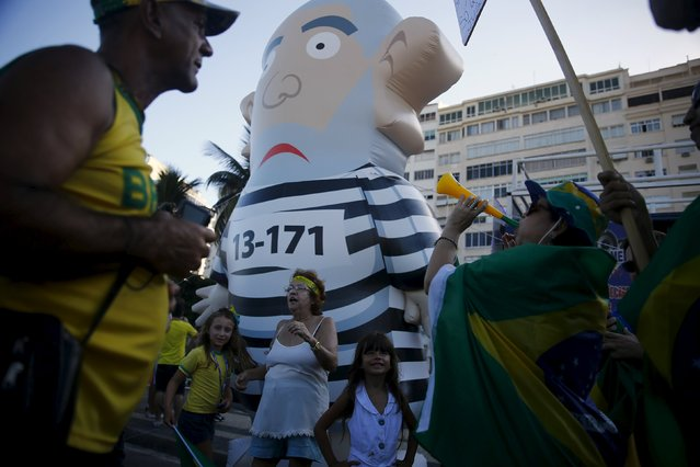 "Demonstrators gather around an inflatable doll known as ""Pixuleco"" of Brazil's former president Luiz Inacio Lula da Silva during a protest against Brazilian President Dilma Rousseff in Rio de Janeiro Brazil, April 17, 2016. (Photo by Pilar Olivares/Reuters)"