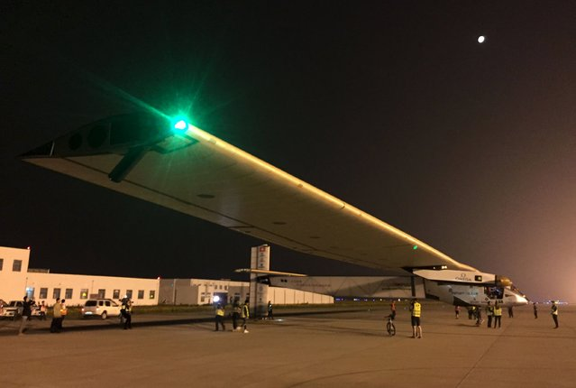 The Solar Impulse 2 plane is seen on the tarmac as it gets ready to take off at the Nanjing Lukou International Airport, Jiangsu province, China, May 31, 2015. The plane took off from eastern China's Nanjing after more than a month of delay to complete the most challenging leg yet of its Round The World adventure: the crossing of the Pacific via Hawaii. Pilots Piccard and Borschberg will take turns at the controls of Solar Impulse 2, which began its journey in Abu Dhabi in the United Arab Emirates on March 9, as it makes its way in the first round-the-world solar-powered flight in about 25 flight days at speeds of between 50 kph and 100 kph (30 mph to 60 mph). REUTERS/Stringer/Solar Impulse/Handout via Reuters