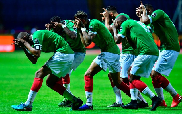 Madagascar's players celebrate their goal during the 2019 Africa Cup of Nations (CAN) football match between Guinea and Madagascar at Alexandria Stadium on June 22, 2019. (Photo by Giuseppe Cacace/AFP Photo)
