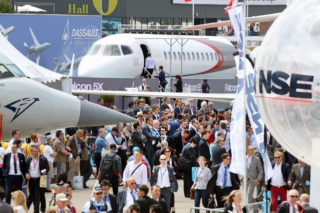 Visitors crowd the alleys of the Paris Air Show in Le Bourget, north of Paris, Tuesday June 16, 2015.  Some 300,000 aviation professionals and spectators are expected at this week's Paris Air Show, coming from around the world to make business deals and see dramatic displays of aeronautic prowess and the latest air and space technology. (AP Photo/Remy de la Mauviniere)