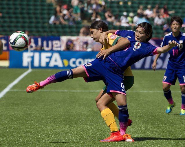Japan's Nahomi Kawasumi (9) and Australia's Samantha Kerr (20) battle for the ball during second half FIFA Women's World Cup quarter-final action in Edmonton, Alberta, Canada. on Saturday June 27, 2015. (Photo by Jason Franson/The Canadian Press via AP Photo)
