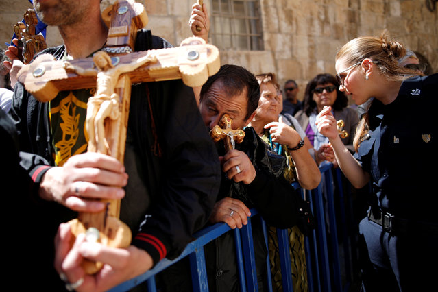 Orthodox Christian worshipers take part in a procession along the Via Dolorosa on Good Friday, during Holy Week in Jerusalem's Old City, April 29, 2016. (Photo by Amir Cohen/Reuters)