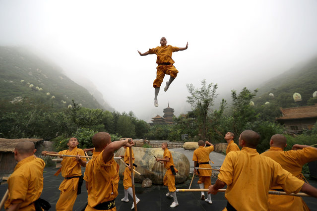 Shaolin boys practice kung fu in the sweltering heat during the zen shaolin music ceremony at shaolin temple, Dengfeng, Henan province, China on August 4, 2019. Shaolin unique skills include: shaolin arhat formation, three gun sashimi, shaolin stick, shaolin stone lock skill, iron hand splitting bricks, water training, fist and foot sparring. (Photo by Sipa Asia/Rex Features/Shutterstock)