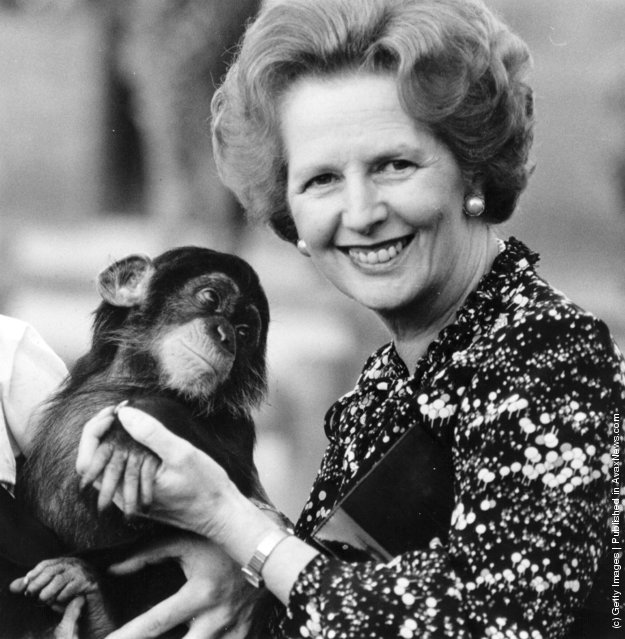 British prime minister Margaret Thatcher (right) holding a chimpanzee, 1985