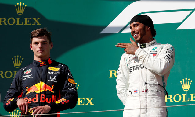 Red Bull's Dutch driver Max Verstappen (L) and Mercedes' British driver Lewis Hamilton stand on the podium after the Formula One Hungarian Grand Prix at the Hungaroring circuit in Mogyorod near Budapest, Hungary, on August 4, 2019. (Photo by Bernadett Szabo/Reuters)
