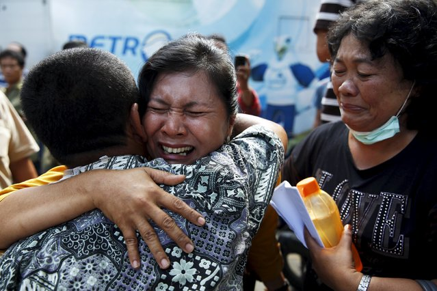 A woman (C) cries after confirming that her brother was among the victims of an Indonesian military C-130 Hercules transport plane that crashed into a residential area, outside the Adam Malik hospital in Medan, Indonesia North Sumatra province July 2, 2015. (Photo by Reuters/Beawiharta)