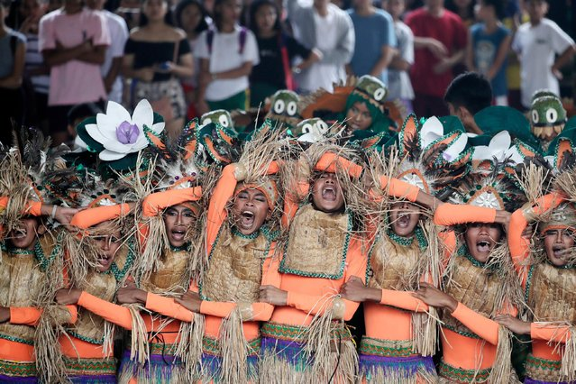 Filipino teens, wearing traditional costumes made from dried water hyacinth stalks, performs during the Water Lily Festival in Las Pinas city, Philippines, 26 July 2019. The Water Lily festival aims to promote the water hyacinth-based livelihood enterprises for residents in flood prone communities of Las Pinas city, according to Senator Cynthia Villar. (Photo by Francis R. Malasig/EPA/EFE)