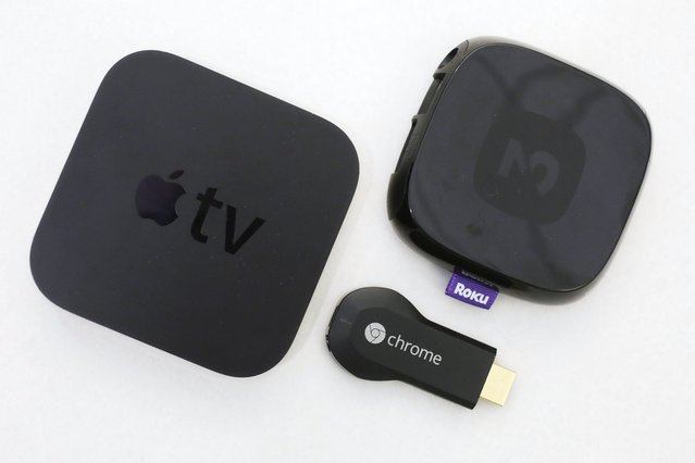 Apple TV started 2007. An Apple TV device, left, is shown alongside Google's Chromecast, center, and the Roku 2, Thursday, December 19, 2013 in New York. Streaming video devices such as Roku, Apple TV and Google's Chromecast project video from Netflix, YouTube and other services onto the big-screen TV. Suddenly, the computer seems inadequate. Internet television will never be the same. (Photo by Mark Lennihan/AP Photo)