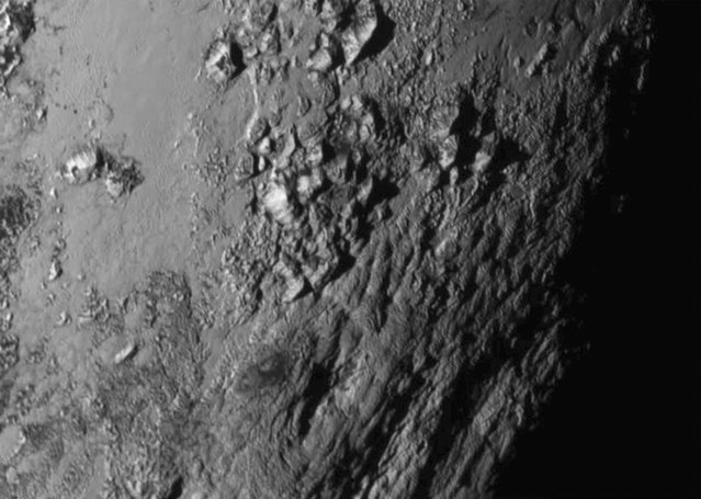 A new close-up image of a region near Pluto's equator reveals a range of youthful mountains rising as high as 11,000 feet (3,500 meters) above the surface of the icy body, in a picture released by NASA in Laurel, Maryland July 15, 2015. (Photo by Reuters/NASA New Horizons)
