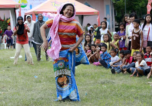 A Muslim mother plays sack race during Eid-al-Fitr celebrations in Taguig city, south of Manila July 18, 2015. (Photo by Romeo Ranoco/Reuters)