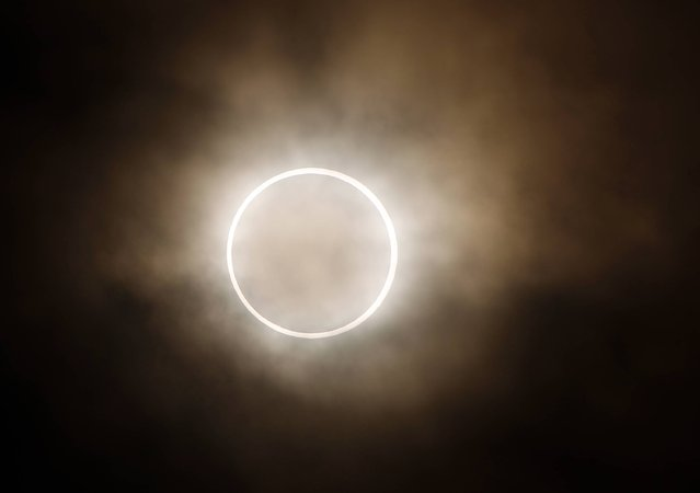 In this May 21, 2012 file photo, the moon slides across the sun, showing a blazing halo of light, during an annular eclipse at a waterfront park in Yokohama, near Tokyo. The first solar eclipse of the year happens Tuesday, April 29, 2014, and will be visible to skygazers in Antarctica, Australia, and the southern Indian Ocean. The eclipse Tuesday is a rare type of annular eclipse, meaning the sun will appear as a ring around the moon. (Photo by Shuji Kajiyama/AP Photo)