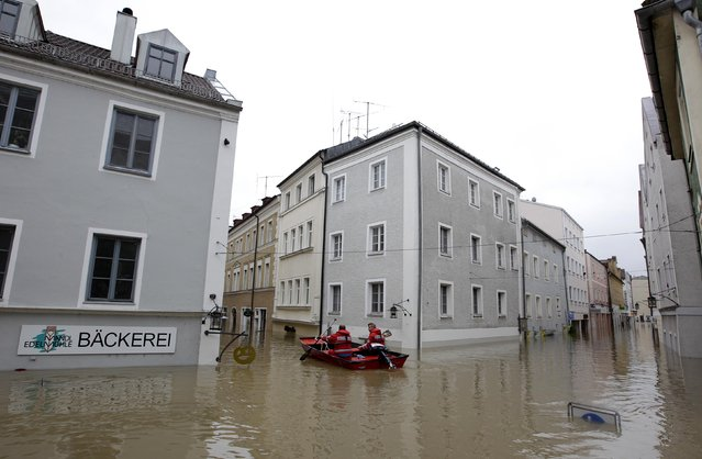 Members of the emergency services travel by boat along flooded streets in the center of the Bavarian town of Passau,  June 3, 2013. REUTERS/Michaela Rehle
