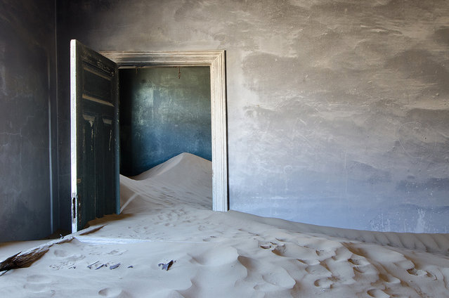 """""""Kolmanskop Interior #6641"""". This image, is one of many of this buildings interior that I photographed. It was so interesting to see the way the sand dunes reclaimed the area over the years. Hard to believe that it was someone's home in 1954. This is just one building in the abandoned area of a diamond mine called Kolmanskop, in Namibia. I spent the entire day here getting better and better at visualizing how to shot these amazing interiors. Photo location: Kolmanskop Diamond Mine, Namibia. (Photo and caption by Bonnie Flamer/National Geographic Photo Contest)"""