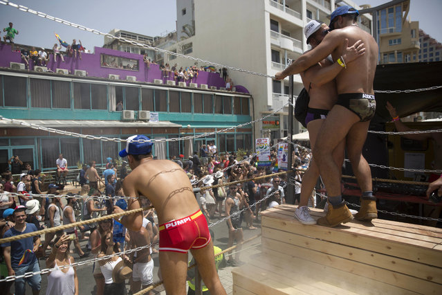 Israeli dancers perform during the annual Gay Pride Parade in Tel Aviv, Israel, Friday, June 3, 2016. (Photo by Oded Balilty/AP Photo)