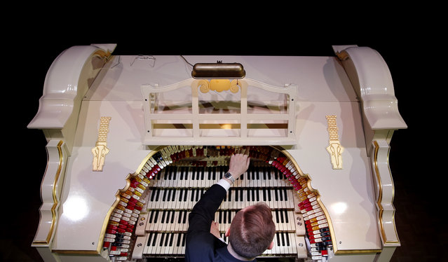 Organist Richard Hill plays a newly restored 1903's American Wurlitzer Theatre Pipe Organ, which is believed to be the largest in Europe, at the Troxy entertainment venue in London, Wednesday, July 29, 2015. The Wurlitzer holds over 1728 pipes ranging from 16 ft (4.9 meters) to 1 inch (2.5 cm) housed in four separate rooms, four keyboards, one pedal board and 241 stop keys, and has taken six years to restore. (Photo by Alastair Grant/AP Photo)