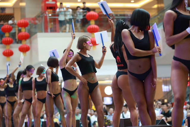 """In this picture taken on June 24, 2017 participants take part in the """"Women's Beautiful Buttock series"""" contest shopping mall in Shenyang, Liaoning province. (Photo by AFP Photo/Stringer)"""