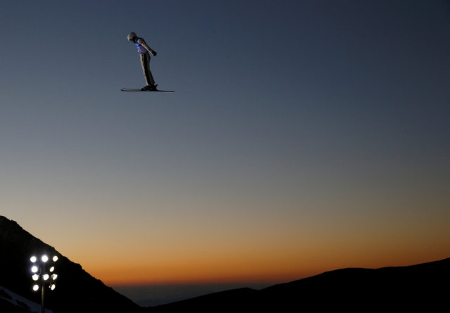 Qi Guangpu of China performs an aerial as he trains during the Snowboarding and Freestyle Skiing World Championships in Sierra Nevada, Spain, March 9, 2017. (Photo by Paul Hanna/Reuters)
