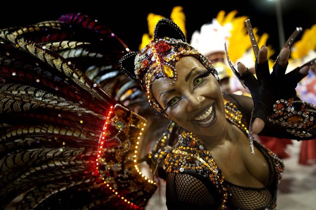 A dancer performs during the parade of the Tom Maior samba school in Sao Paulo