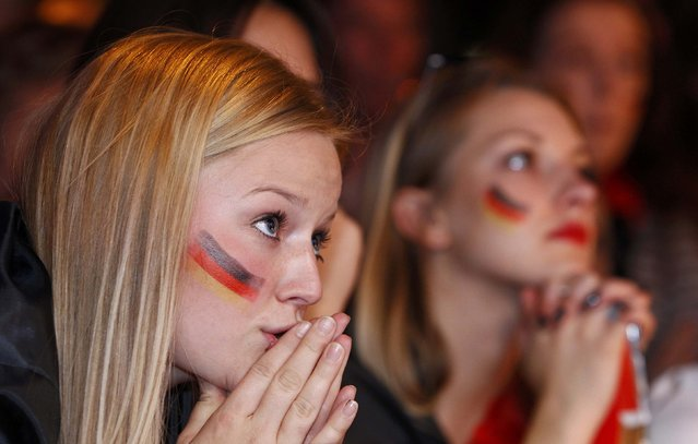 Fans of Germany react as they watch the 2014 World Cup final between Germany and Argentina in Brazil at a public screening of the match in Munich July 13, 2014. (Photo by Michaela Rehle/Reuters)
