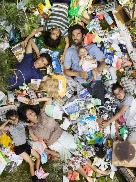 Joya, Santiniketa, Rabindranath, Chandramoha, Ben, Bodihisattba, and Omjabarindra surrounded by seven days of their own rubbish in Pasadena, California. (Photo by Gregg Segal/Barcroft Media)