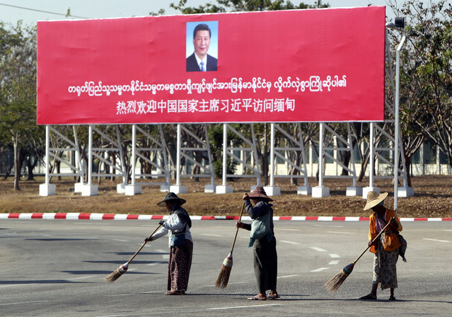 Municipal workers sweep on a road near a welcoming billboard to Chinese President Xi Jinping Friday, January 17, 2020, in Naypyitaw, Myanmar. China's President Xi Jinping was heading to Myanmar on Friday for a state visit likely to deepen the countries' already close bilateral relations at a critical time. (Photo by Aung Shine Oo/AP Photo)