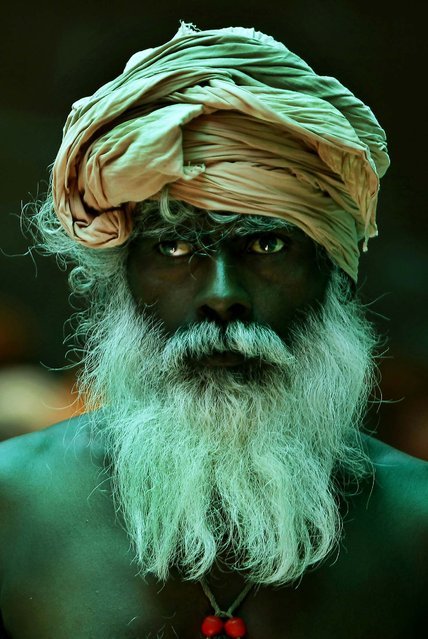 A Hindu holy man looks on as he waits to register for the annual pilgrimage to the Amarnath cave shrine in Jammu, India