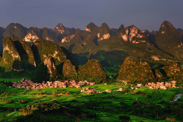 File photo taken on July 3, 2012 shows the scenery of karst landform in Dacai Township under Maonan Autonomous County of Huaijiang, south China's Guangxi Zhuang Autonomous Region. The World Heritage Committee on Monday inscribed an extension of South China Karst, a natural World Heritage Site since 2007, into the UNESCO's World Heritage List. (Photo by Wang Xiufa/Xinhua)