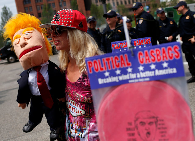 April Brucker, with the gourd stand against Trump, holds a Donald Trump puppet in public square outside the Republican National Convention in Cleveland, Ohio, U.S. July 18, 2016. (Photo by Shannon Stapleton/Reuters)