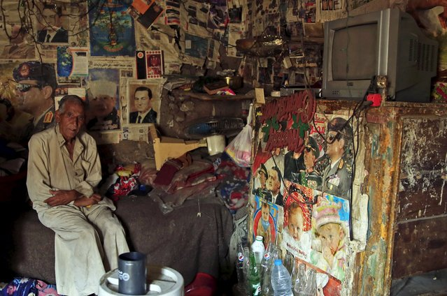 67-year-old El Hag Sayed poses for a photograph in his self-built house, which is decorated with pictures of Egyptian President Abdel Fattah al-Sisi and ousted president Hosni Mubarak, in the Eshash el-Sudan slum in the Dokki neighbourhood of Giza, south of Cairo, Egypt September 2, 2015. (Photo by Amr Abdallah Dalsh/Reuters)