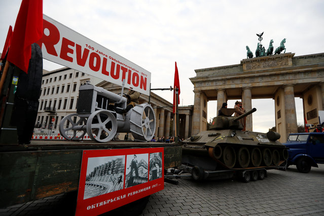 People take part in a parade to mark the Red October revolution's centenary in Berlin, Germany November 7, 2017, Germany on November 7, 2017. (Photo by Fabrizo Bensch/Reuters)