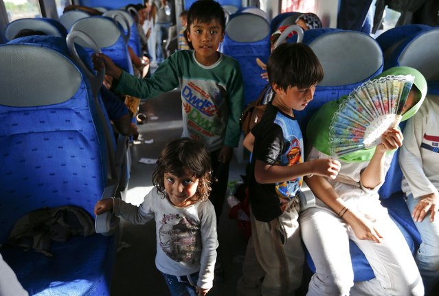 Migrant children wait inside a train at the station in Beli Manastir, Croatia September 18, 2015. (Photo by Laszlo Balogh/Reuters)