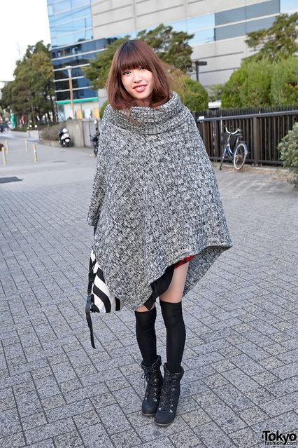 A Japanese girl wearing a cute poncho outside of the Harajuku Kawaii in Tokyo. (Tokyo Fashion)
