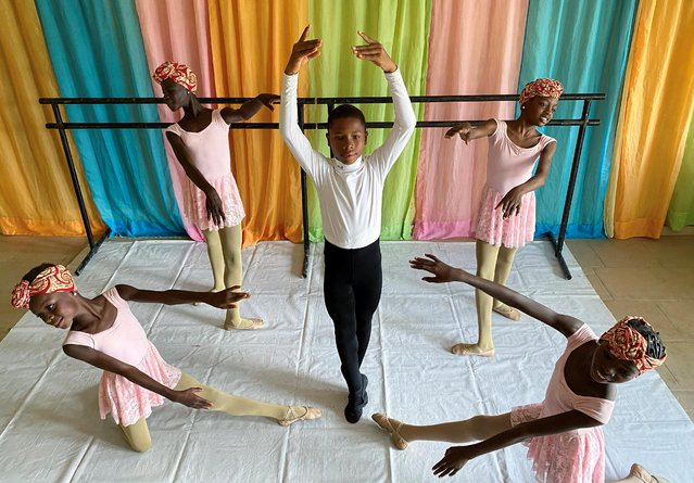 Anthony Mmesoma Madu, an 11-year-old ballet dancer, poses during a rehearsal with other students at the Leap of Dance Academy in Lagos, Nigeria July 27, 2020. A video of Anthony dancing barefoot in the rain on concrete outside the studio where he trains, the Leap of Dance Academy, went viral last month. More than 15 million people have watched his joyful leaps and pirouettes, undeterred by the rain and coarse surface. (Photo by Seun Sanni/Reuters)