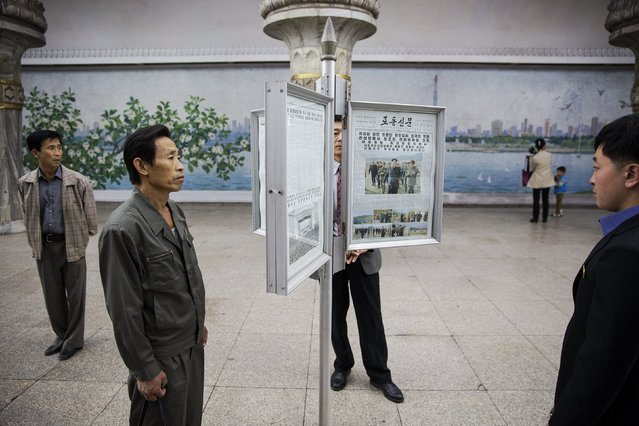 People read newspapers displayed inside a subway station visited by foreign reporters during a government organised tour in Pyongyang, North Korea October 9, 2015. One of the world's most inaccessible places, North Korea has invited foreign journalists to Pyongyang this week for celebrations marking the 70th anniversary of its ruling Workers' Party scheduled for October 10. (Photo by Damir Sagolj/Reuters)