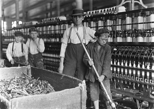 """Sweeper and doffer boys in Lancaster Cotton Mills, December 1, 1908"". (Photo by Lewis Hine)"