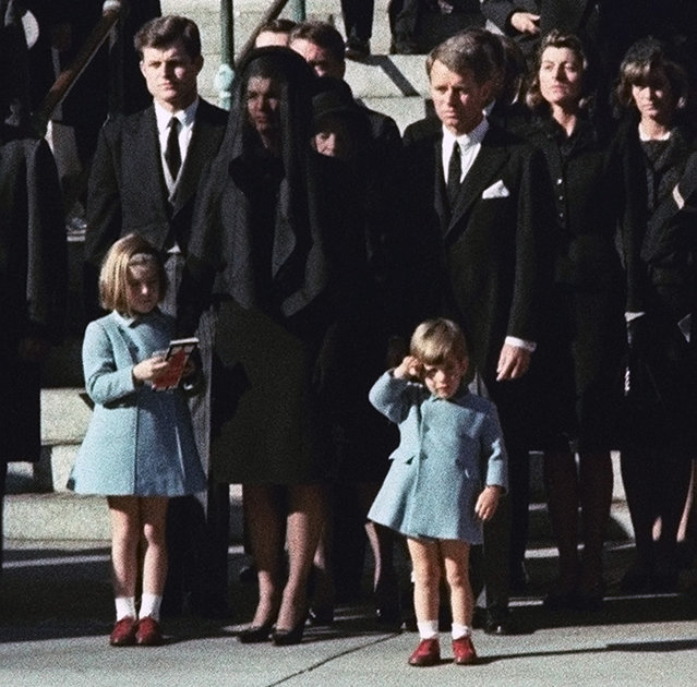Three-year-old John F. Kennedy Jr. salutes his father's casket in Washington in this November 25, 1963 photo, three days after the president was assassinated in Dallas. Widow Jacqueline Kennedy, center, and daughter Caroline Kennedy are accompanied by the late president's brothers Senator Edward Kennedy, left, and Attorney General Robert Kennedy. (Photo by AP Photo)