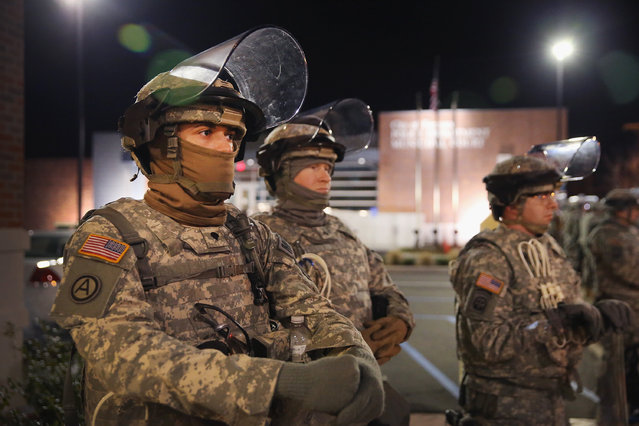 Soldiers with the Missouri National Guard stand guard outside the Ferguson police station on November 25, 2014 in Ferguson, Missouri. Last night rioting erupted following the grand jury announcement to not indict officer Darren Wilson in the Michael Brown case. (Photo by Scott Olson/Getty Images)