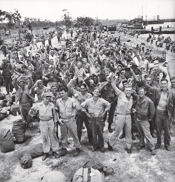 American troops in the Philippines celebrate the long-awaited news that Japan has, finally, unconditionally, surrendered in August 1945. (Photo by Carl Mydans/Time & Life Pictures)