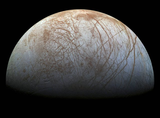 A new mosaic made from images taken by NASA's Galileo spacecraft in the late 1990's is shown of the surface of Jupiter's icy moon, Europa, as it looms large in this newly-reprocessed, higher resolution color view in this handout provided by NASA November 24, 2014. (Photo by Reuters/NASA/JPL-Caltech/SETI Institue)