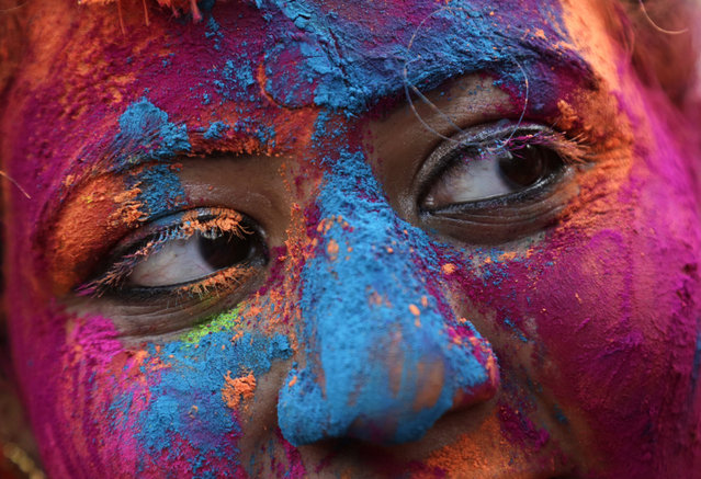 The face of a woman is smeared with colored powder during Holi, the Hindu festival of colors in Kolkata, India, Thursday, March 1, 2018. (Photo by Bikas Das/AP Photo)