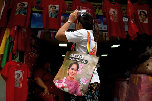 A supporter of the National League for Democracy (NLD) looks at T-shirts with an image of Myanmar State Counsellor Aung San Suu Kyi at a printing shop in Yangon, Myanmar on August 21, 2020. The NLD announced that they will participate with more than 1,000 candidates in the upcoming general election scheduled for November 8, 2020. (Photo by Shwe Paw Mya Tin/NurPhoto via Getty Images)