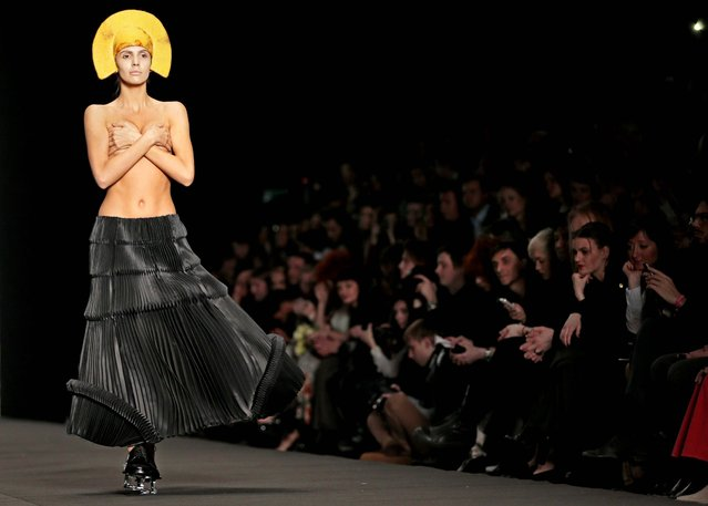A model displays a creation by Georgian designer Ria Keburia during Moscow Fashion Week, on March 30, 2013. (Photo by Mikhail Metzel/Associated Press)