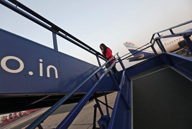 A passenger boards an Indigo Airlines' flight bound for Srinagar at an airport in New Delhi November 21, 2014. Picture taken November 21, 2014. (Photo by Adnan Abidi/Reuters)