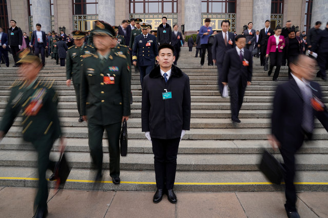 Security personnel stand guard in front of the Great Hall of the People after the second plenary session of the National People's Congress (NPC) in Beijing, China, March 9, 2018. (Photo by Jason Lee/Reuters)