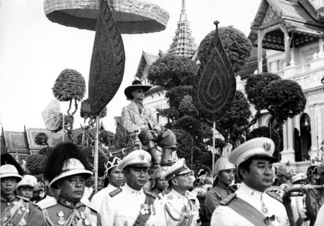 King Bhumibol Adulyadej of Thailand is carried on the shoulders of Royal guards during a parade in Bangkok December 7, 1963. The parade climaxed one week-long celebration of the King's 36th birthday. (Photo by AP Photo)