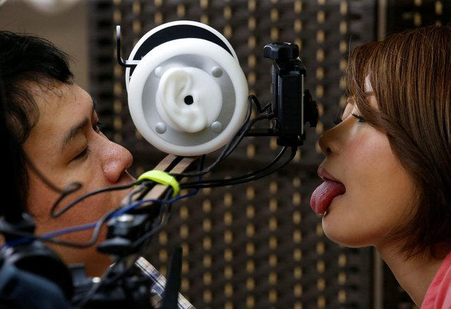 Adult video actress Yuri Oshikawa performs a kiss scene in front of a FutureLeap's 3D virtual reality camera, equipped with a human ear-shaped mic, during a rehearsal for ROCKET's 3D VR adult film at the company's studio in Tokyo, Japan, July 31, 2017. (Photo by Kim Kyung-Hoon/Reuters)
